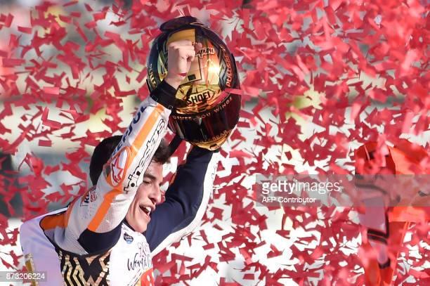 Repsol Honda Team's Spanish rider Marc Marquez celebrates after the MotoGP race of the Valencia Grand Prix at Ricardo Tormo racetrack in Cheste near...