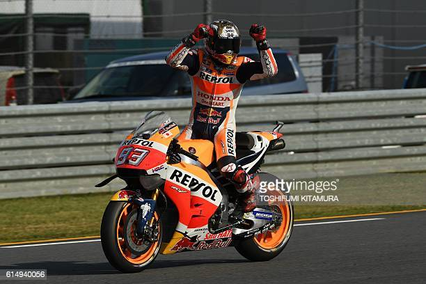 TOPSHOT Repsol Honda Team's Spanish rider Marc Marquez celebrates his win at the MotoGP Japanese Grand Prix and for securing his third world...