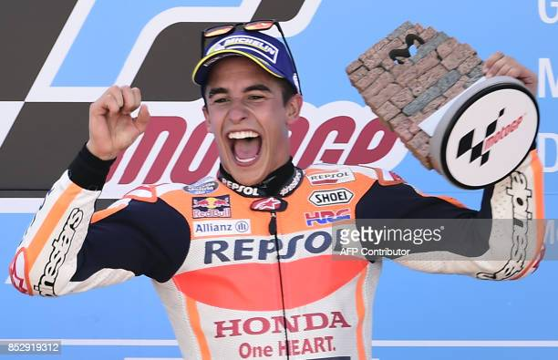 Repsol Honda Team's Spanish rider Marc Marquez celebrates on the podium winning the MOTO GP race of the Moto Grand Prix of Aragon at the Motorland...