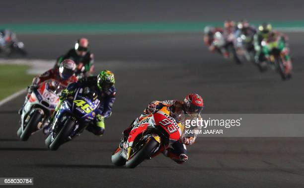 Repsol Honda Team's Spanish rider Marc Marquez competes during the 2017 Qatar MotoGP at the Losail International Circuit north of the capital Doha on...