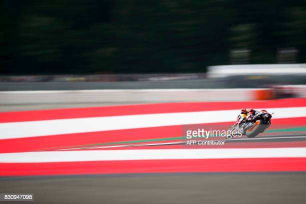 TOPSHOT Repsol Honda Team's Spanish rider Marc Marquez competes during the warm up session prior to the MotoGP Austrian Grand Prix race at Red Bull...