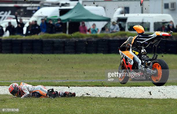 Repsol Honda Team's Spanish rider Marc Marquez crashes out during the Australian MotoGP race at Phillip Island on October 23 2016 / AFP / DEUS IMAGES...