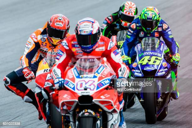 Repsol Honda Team's Spanish rider Marc Marquez Ducati Team's Italian rider Andrea Dovizioso Monster Yamaha Tech 3's French rider Johann Zarco and...