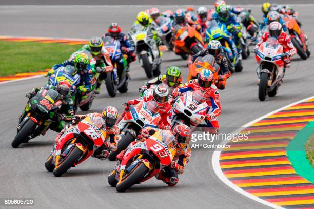 Repsol Honda Team's Spanish rider Marc Marquez leads the pack during the MotoGP competition of the Moto Grand Prix of Germany at the Sachsenring...