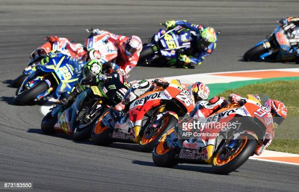 Repsol Honda Team's Spanish rider Marc Marquez leads the pack during the MotoGP race of the Valencia Grand Prix at Ricardo Tormo racetrack in Cheste...