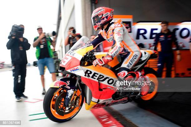 Repsol Honda Team's Spanish rider Marc Marquez leaves the box during the Moto GP first free practice during the Moto Grand Prix of Aragon at the...
