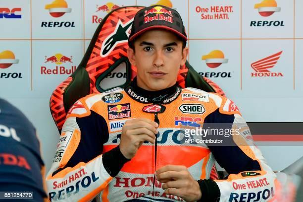 Repsol Honda Team's Spanish rider Marc Marquez looks on during the Moto GP first free practice during the Moto Grand Prix of Aragon at the Motorland...