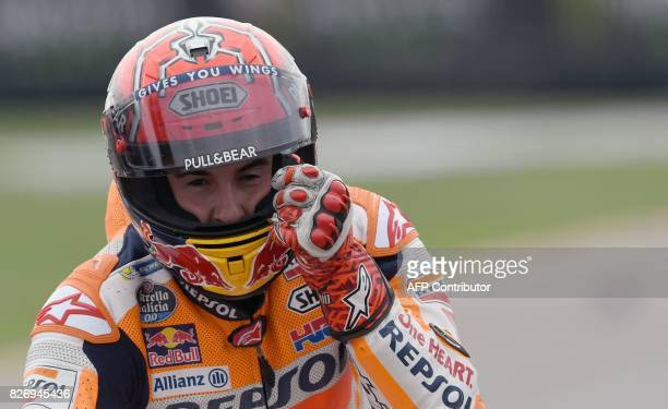 Repsol Honda Team's Spanish rider Marc Marquez reacts after the MotoGP event of the Grand Prix of the Czech Republic in Brno on August 6 2017 / AFP...