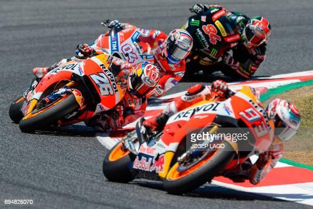 Repsol Honda Team's Spanish rider Marc Marquez Repsol Honda Team's Spanish rider Dani Pedrosa Ducati Team's Italian rider Andrea Dovizioso and...