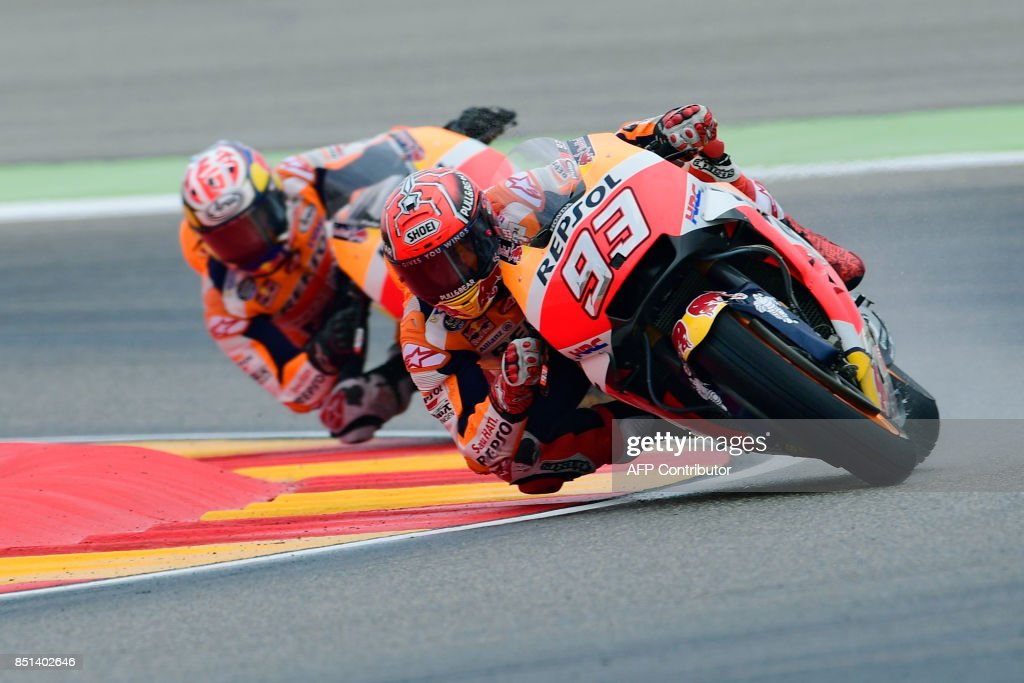 Repsol Honda Team's Spanish rider Marc Marquez (R) rides ahead of Repsol Honda Team's Spanish rider Dani Pedrosa during the Moto GP second free pratice of the Moto Grand Prix of Aragon at the Motorland circuit in Alcaniz on September 22, 2017. /