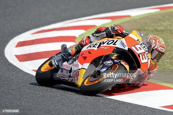 repsol honda team 39 s spanish rider marc marquez rides at the barcelona catalunya racetrack in. Black Bedroom Furniture Sets. Home Design Ideas