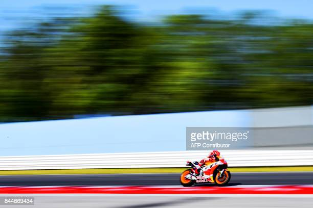 Repsol Honda team's spanish rider Marc Marquez rides during a practice session for the San Marino Moto GP Grand Prix race at the Marco Simoncelli...