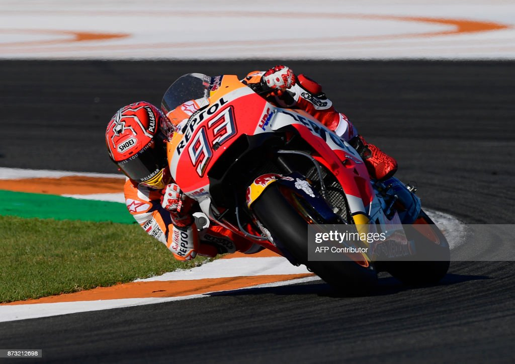 Repsol Honda Team's Spanish rider Marc Marquez rides during the MotoGP race of the Valencia Grand Prix at Ricardo Tormo racetrack in Cheste, near Valencia on November 12, 2017. Spain's Marc Marquez sealed his sixth world championship and fourth in the premier MotoGP category with third place at the Valencia Grand Prix. Marquez's Honda teammate Dani Pedrosa won the race from France's Johann Zarco in second. MARCOU