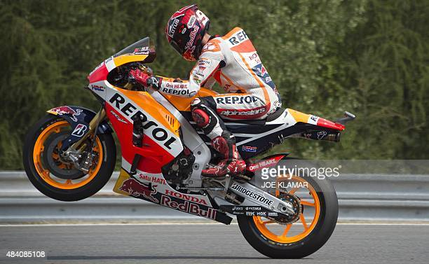 Repsol Honda Team's Spanish rider Marc Marquez rides his motorbike during the third free practice session of the Moto GP Czech Grand Prix in Brno...