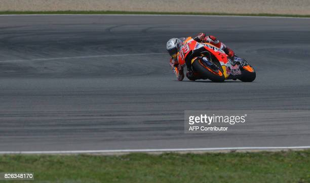 TOPSHOT Repsol Honda Team's Spanish rider Marc Marquez rides in a free practice session prior to the Moto GP Czech Grand Prix race in Brno Czech...