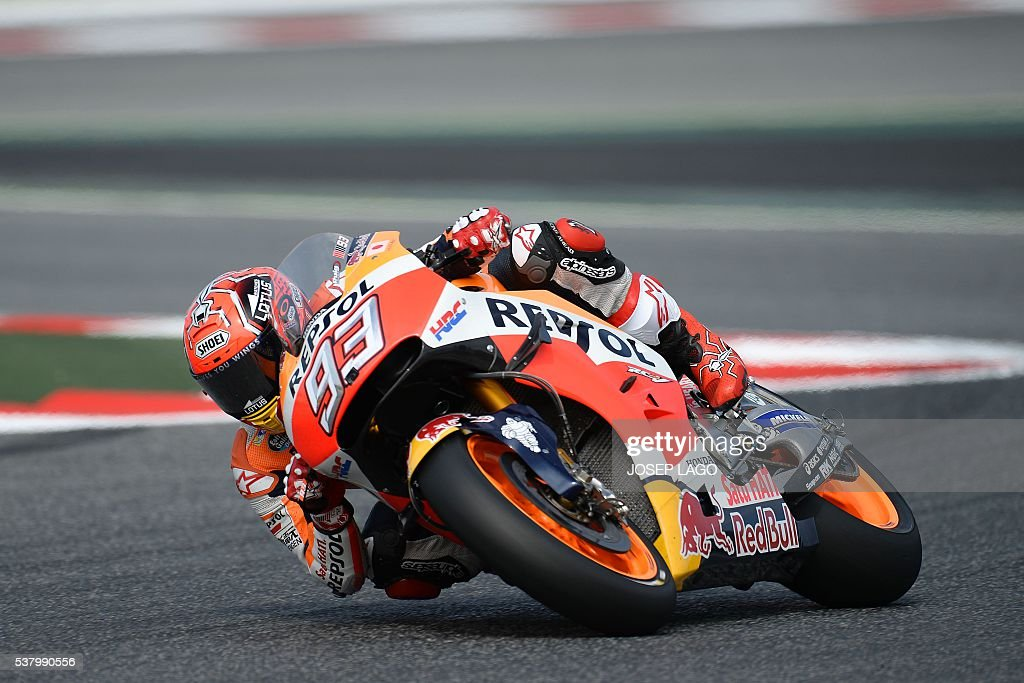 Repsol Honda Team's Spanish rider Marc Marquez rides in the chicane included in the racetrack, due to yesterday Spanish rider Luis Salom's fatal accident, at the Catalunya racetrack in Montmelo, near Barcelona, on June 4, 2016, during the Catalunya Moto GP Grand Prix third free practice session. / AFP / JOSEP
