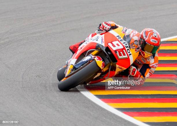 Repsol Honda Team's Spanish rider Marc Marquez steers his bike during the training session of the Moto Grand Prix of Germany at the Sachsenring...