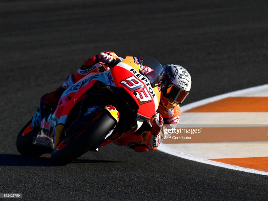 Repsol Honda Team's Spanish rider Marc Marquez takes a curve during the first MotoGP free practice session of the race of the Valencia Grand Prix at Ricardo Tormo racetrack in Cheste, near Valencia on November 10, 2017. /