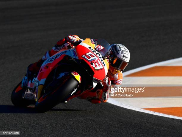 Repsol Honda Team's Spanish rider Marc Marquez takes a curve during the first MotoGP free practice session of the race of the Valencia Grand Prix at...