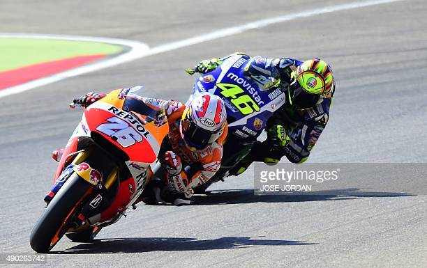 Repsol Honda's Spanish rider Dani Pedrosa competes with Yamaha Team's Italian rider Valentino Rossi during the Moto GP race of the Aragon Grand Prix...