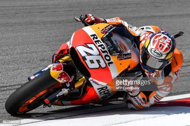 TOPSHOT Repsol Honda's Spanish rider Dani Pedrosa takes a corner during the third practice session of the Malaysia MotoGP at the Sepang International...