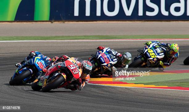 Repsol Honda's Spanish rider Marc Marquez leads the pack during the Moto GP race of the Aragon Grand Prix at the Motorland racetrack in Alcaniz on...