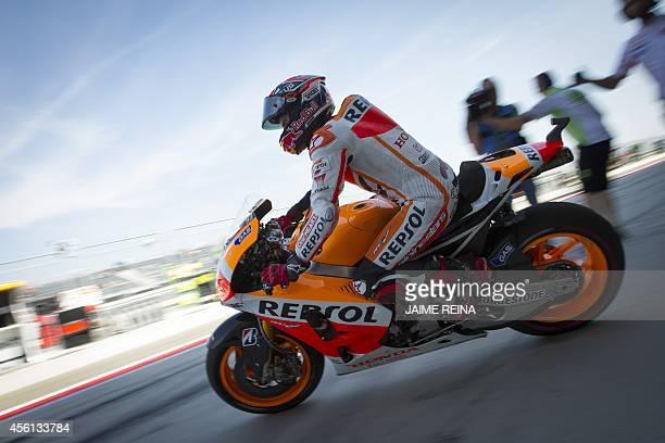 Repsol Honda's Spanish rider Marc Marquez leaves the box during the second MotoGP free practice session ahead of the Aragon Grand Prix at the...