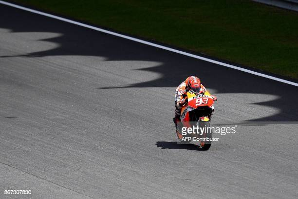 TOPSHOT Repsol Honda's Spanish rider Marc Marquez powers his bike during the qualifying session of the Malaysia MotoGP at the Sepang International...