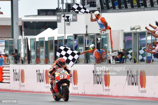 Repsol Honda's Spanish rider Spanish Marc Marquez crosses the finish line and wins the San Marino Moto GP Grand Prix at the Marco Simoncelli Circuit...