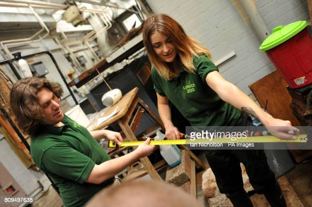Reptile keepers Sarah Dempsey and Glynn Hennessy measure a Pueblan Milk Snake as part the annual weighin at ZSL London Zoo