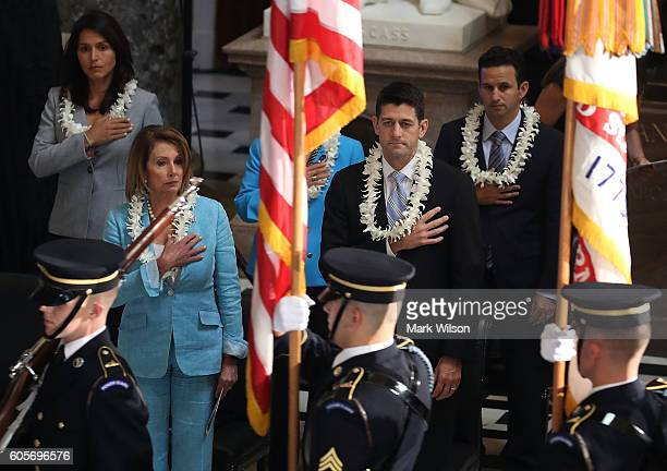RepTulsi Gabbard House Minority Leader Nancy Pelosi House Speaker Paul Ryan and Rep Brian Schatz participate in a memorial service to honor the late...
