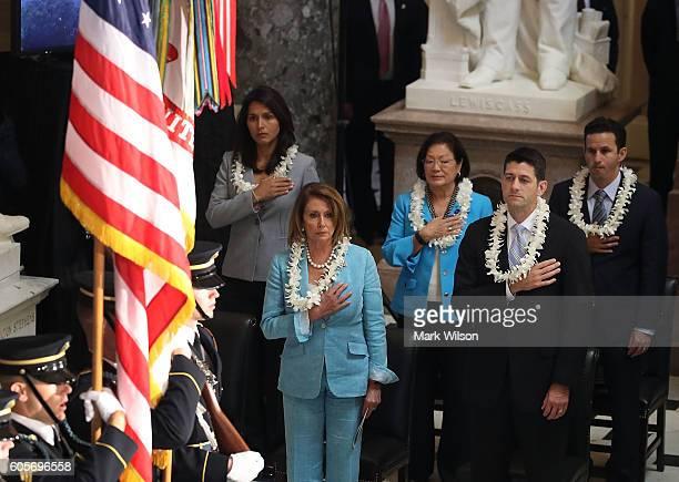 RepTulsi Gabbard House Minority Leader Nancy Pelosi Sen Mazie Hirono Sen House Speaker Paul Ryan and Rep Brian Schatz participate in a memorial...