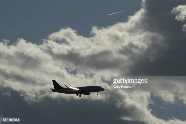 Republic Airways airplane passes through clouds on approach to Newark Liberty Airport on May 15 as seen from Elizabeth New Jersey