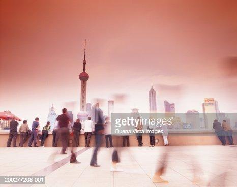 Republic of China, Shanghai, Bund, people in plaza (long exposure) : Stock Photo