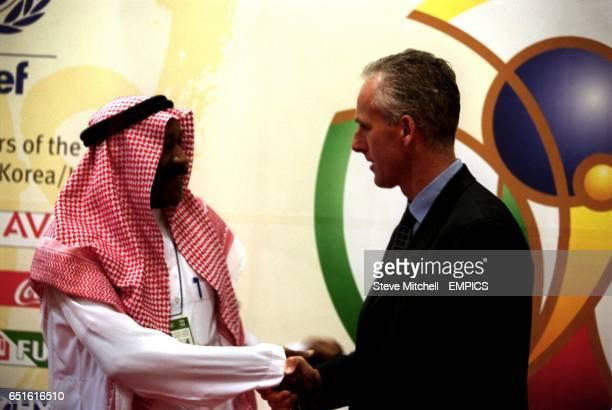 Republic Of Ireland Coach Mick McCarthy meets Saudi Arabia's Coach Nassar Abdul Aziz Al Jawhar after the World Cup 2002 draw in Korea