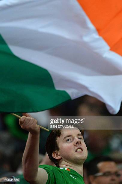 A Republic of Ireland fan waves a flag during the international friendly football match between England and Republic of Ireland at Wembley Stadium in...