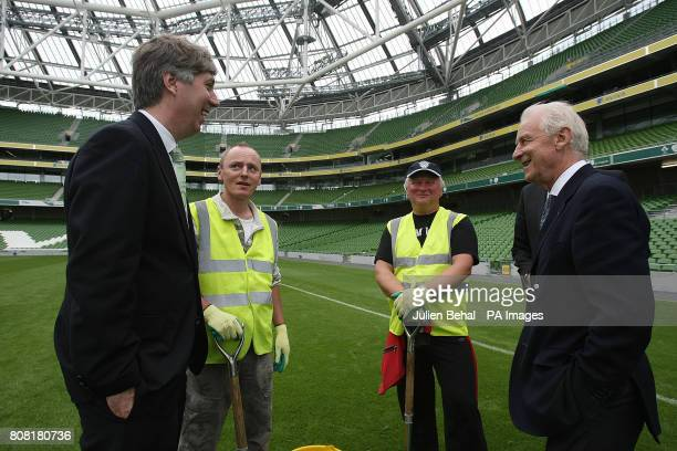 Republic of Ireland manager Giovanni Trapattoni and FAI CEO John Delaney chat to grounds keepers repairing the pitch during the announcement that...