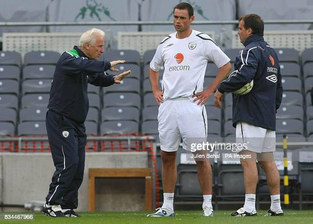 Republic of Ireland manager Giovanni Trapattoni and Marco Tardelli talking with Damien Delaney during a training session at Croke Park Dublin