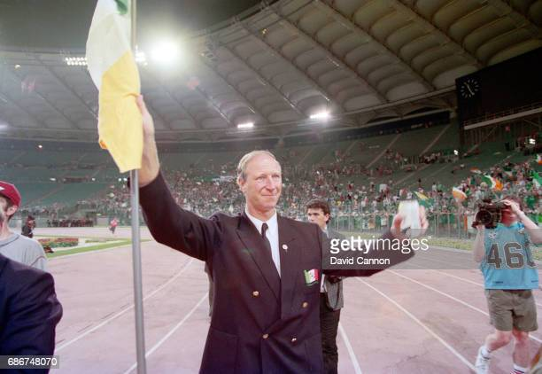 Republic of Ireland manager Jack Charlton waves a flag to supporters after the 1990 FIFA World Cup quarter Final defeat against Italy at the Olympic...