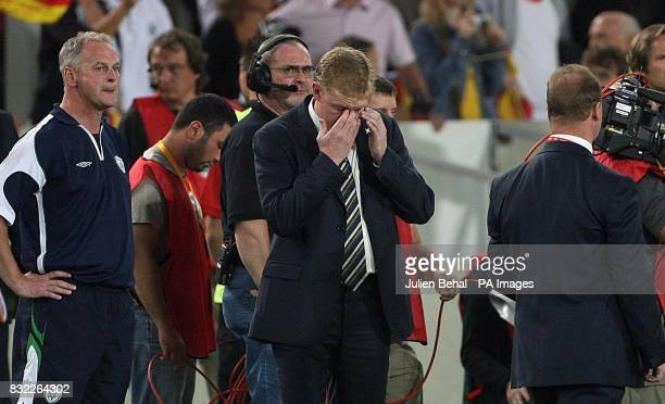 Republic of Ireland manager Steve Staunton holds his head in disappointment with head coach Kevin McDonnell looking on after the European...