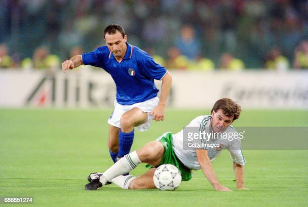 Republic of Ireland player Ray Houghton is challenged by Salvatore Schillaci during the 1990 FIFA World Cup quarter Final defeat against Italy at the...