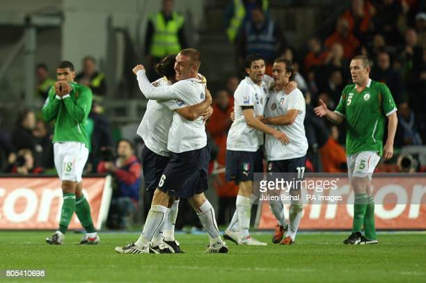 Republic of Ireland players are left dejected as Italy celebrate Alberto Gilardino's late equaliser