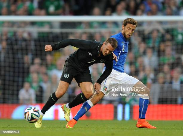 Republic of Ireland's Aiden McGeady and Italy's Claudio Marchisio battle for the ball during the International Friendly at Craven Cottage London