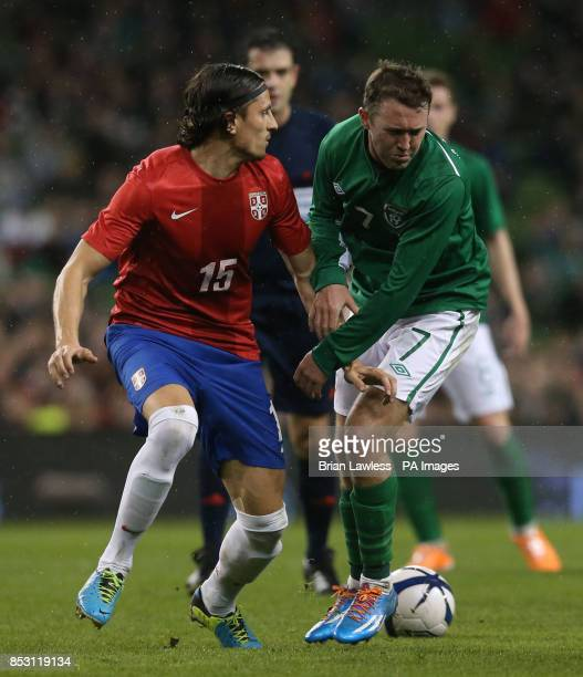 Republic of Ireland's Aiden McGeady and Serbia's Ljubomir Fejsa during the international friendly at The Aviva Stadium Dublin