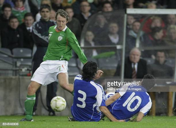 Republic of Ireland's Aiden McGeady tackles Cyprus' Elias Charalambous and Alexandros Garpozis during the FIFA World Cup Qualifying match at Croke...