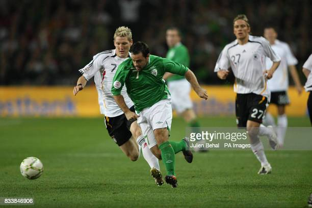 Republic of Ireland's Andrew Reid in action against Germany's Bastian Schweinsteiger during the UEFA European Championship Qualifying match at Croke...