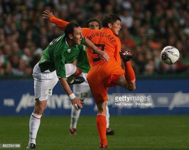 Republic of Ireland's Andy O'Brien and Holland's Klaas Van Huntelaar in action during a friendly international at Lansdowne Road in Dublin