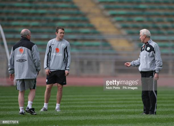 Republic of Ireland's Assistant manager Liam Brady and manager Giovanni Trapattoni talk to Aiden McGeady during training