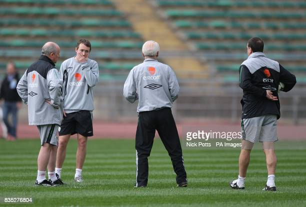 Republic of Ireland's Assistant manager Liam Brady manager Giovanni Trapattoni and Marco Tardelli talk to Aiden McGeady during training