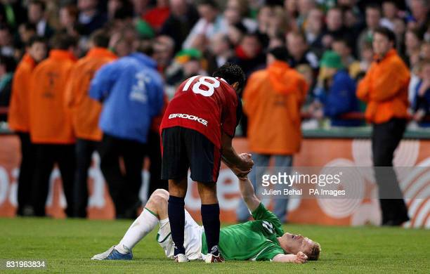 Republic of Ireland's Damien Duff shows his dejection as Chile's Gonzalo Jara helps him up at full time following the international friendly match at...